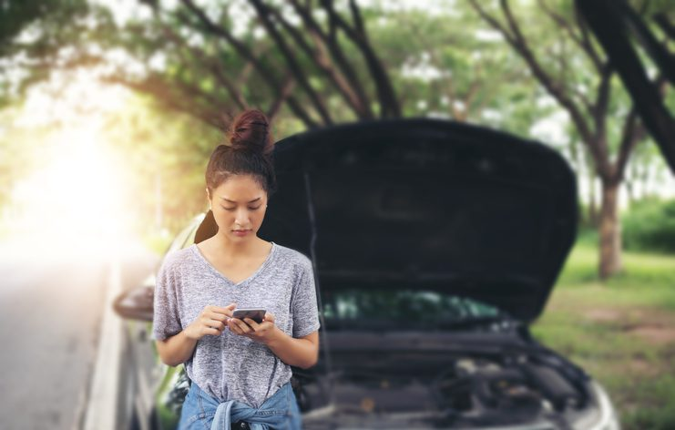 Millenial woman calling insurance to discuss roadside assistance coverage